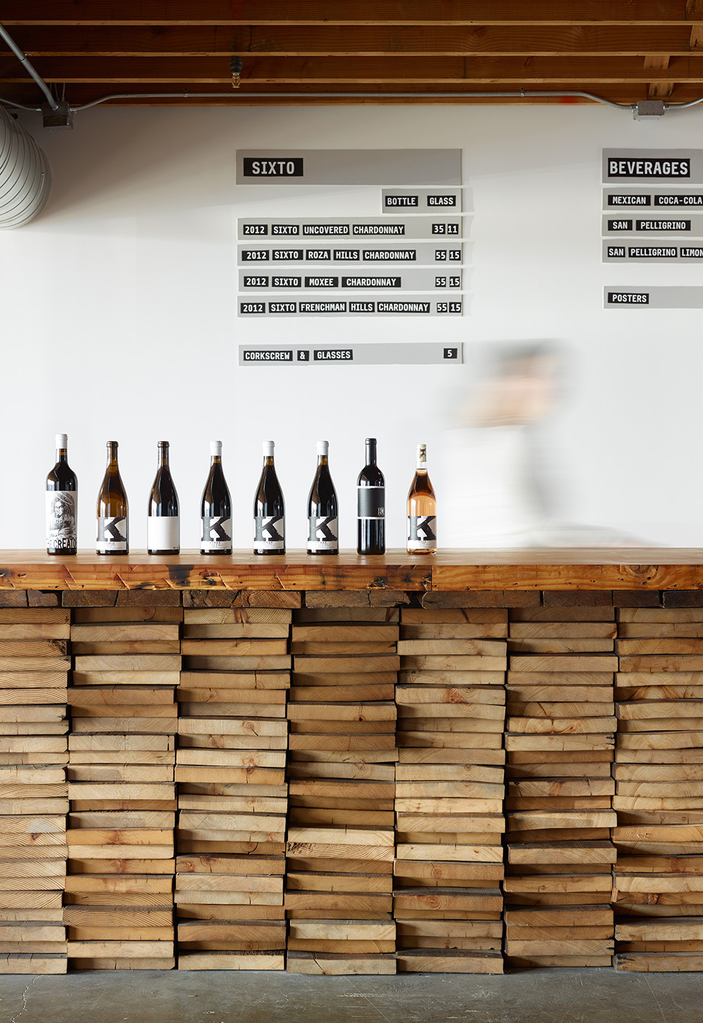 The entry-level lounge bar made of stacked, salvaged wood.
