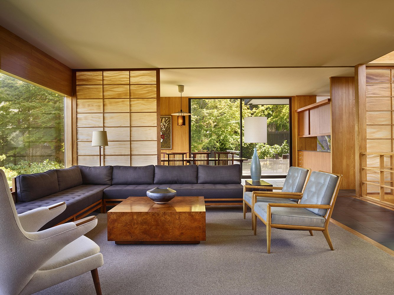 Many of the home's original furnishings were reupholstered including a sectional in the living room
