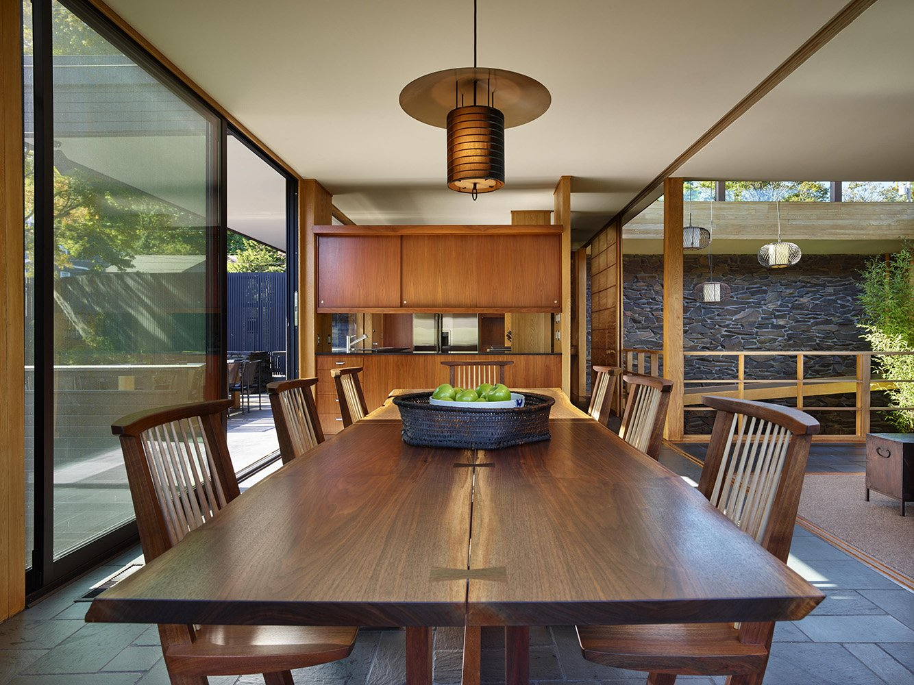 A custom-sized table and chair set graces the dining room designed by Northwest woodworker George Nakashima