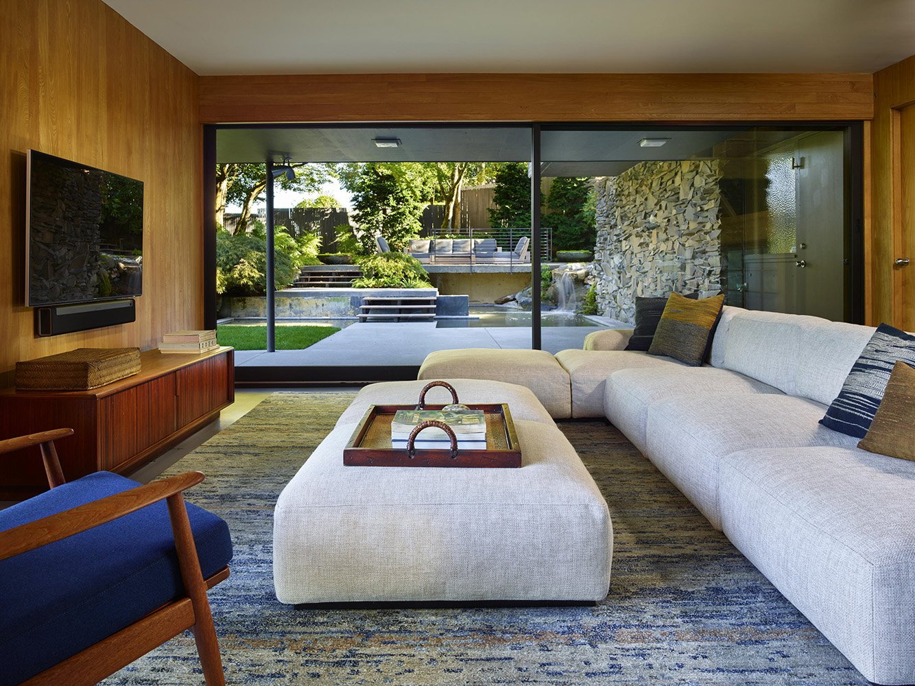 Lower level family room windows frame the restored landscape design by William Teufel