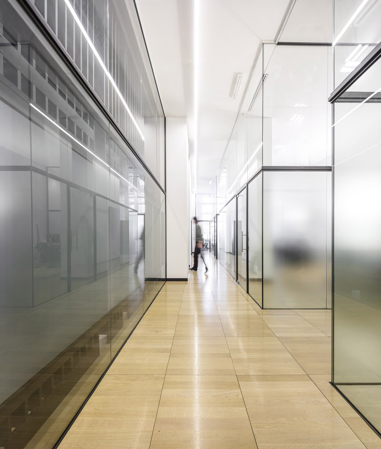 Only glass partions divides the office spaces from each other Fernando Guerra