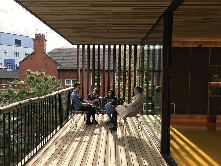 The sunny south facing balcony with birch log handrail. Alex de Rijke