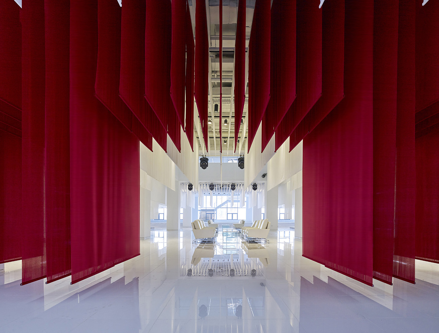 Layers of red fabric conjure images of a Chinese gate   YANG Chao Ying