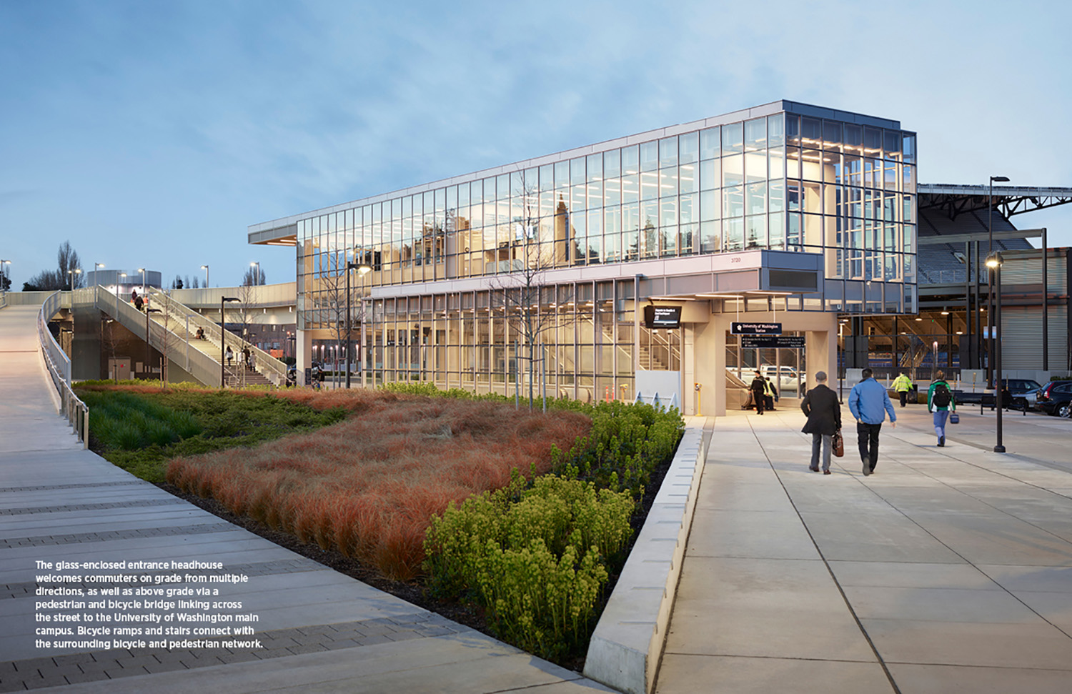 The glass-enclosed entrance headhouse welcomes commuters on grade from multiple directions, as well as above grade via a pedestrian and bicycle bridge linking across the street to the University of Washing Kevin Scott}