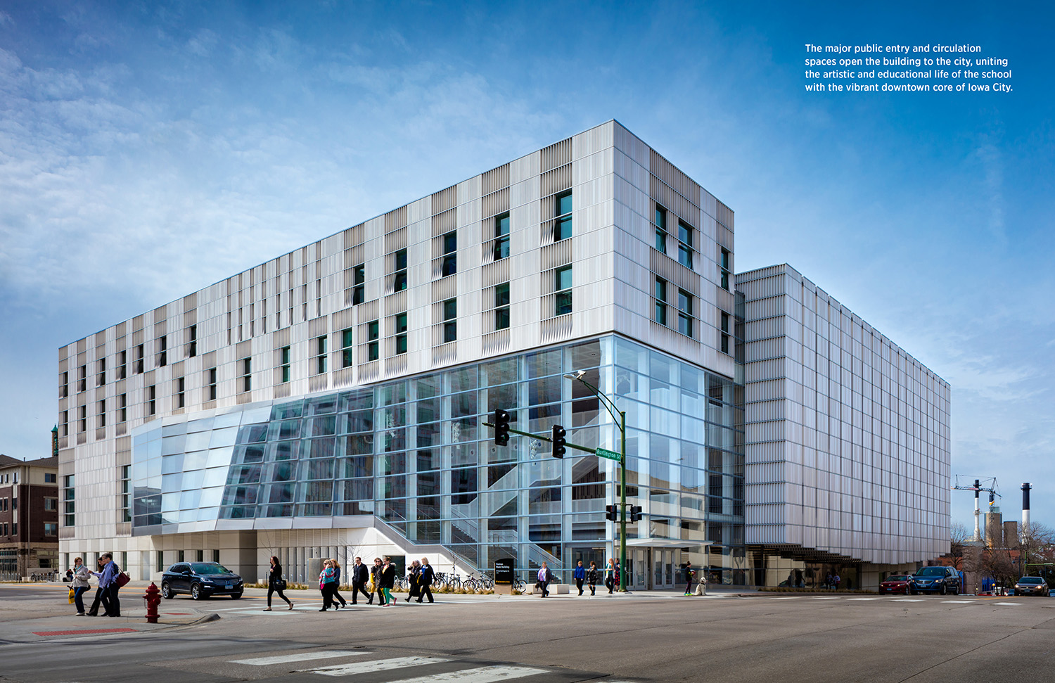 The major public entry and circulation spaces open the building to the city, uniting the artistic and educational life of the school with the vibrant downtown core of Iowa city. Tim Griffith}