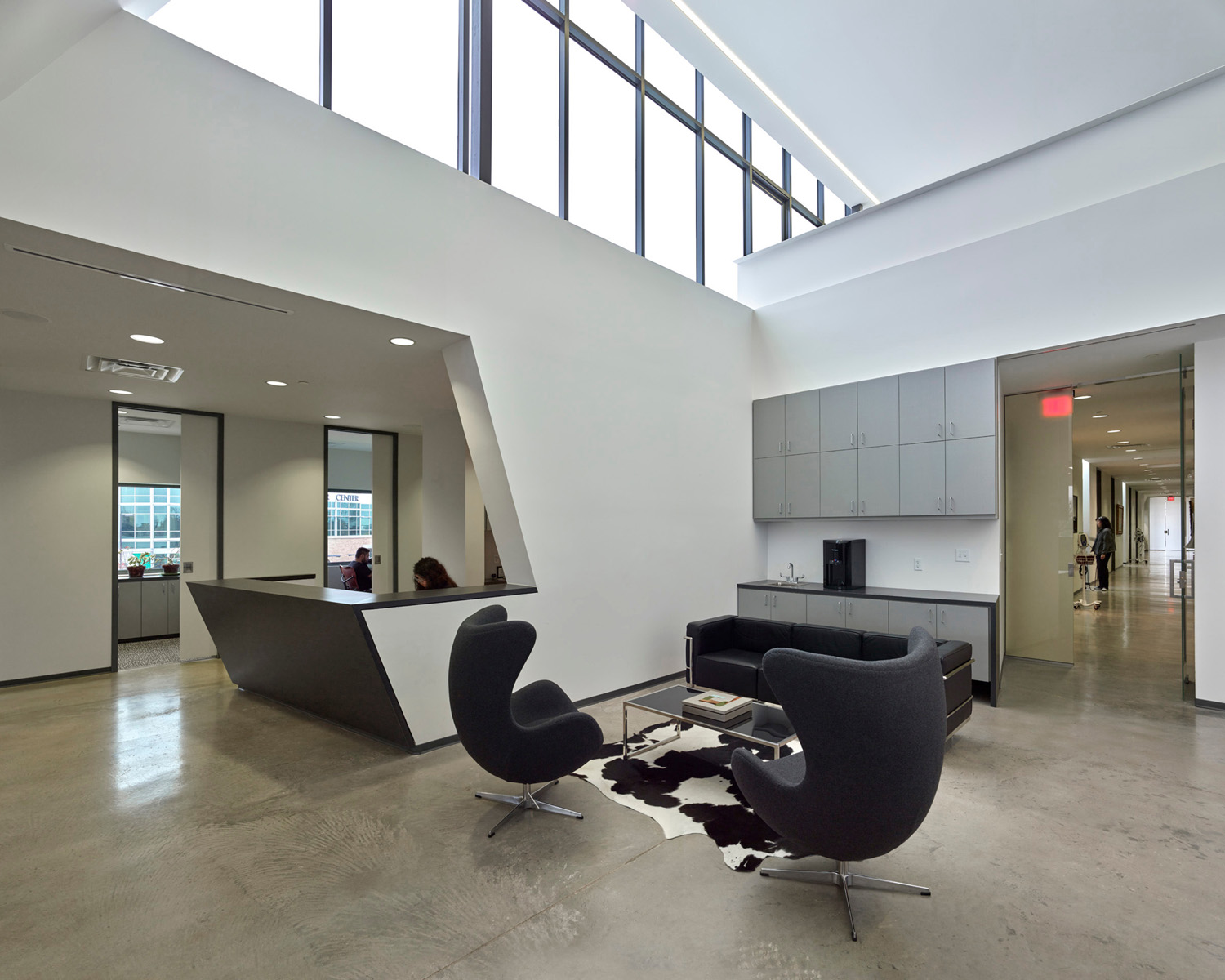 Double height Flex Space in administrative area; south clinic corridor beyond and mezzanine above