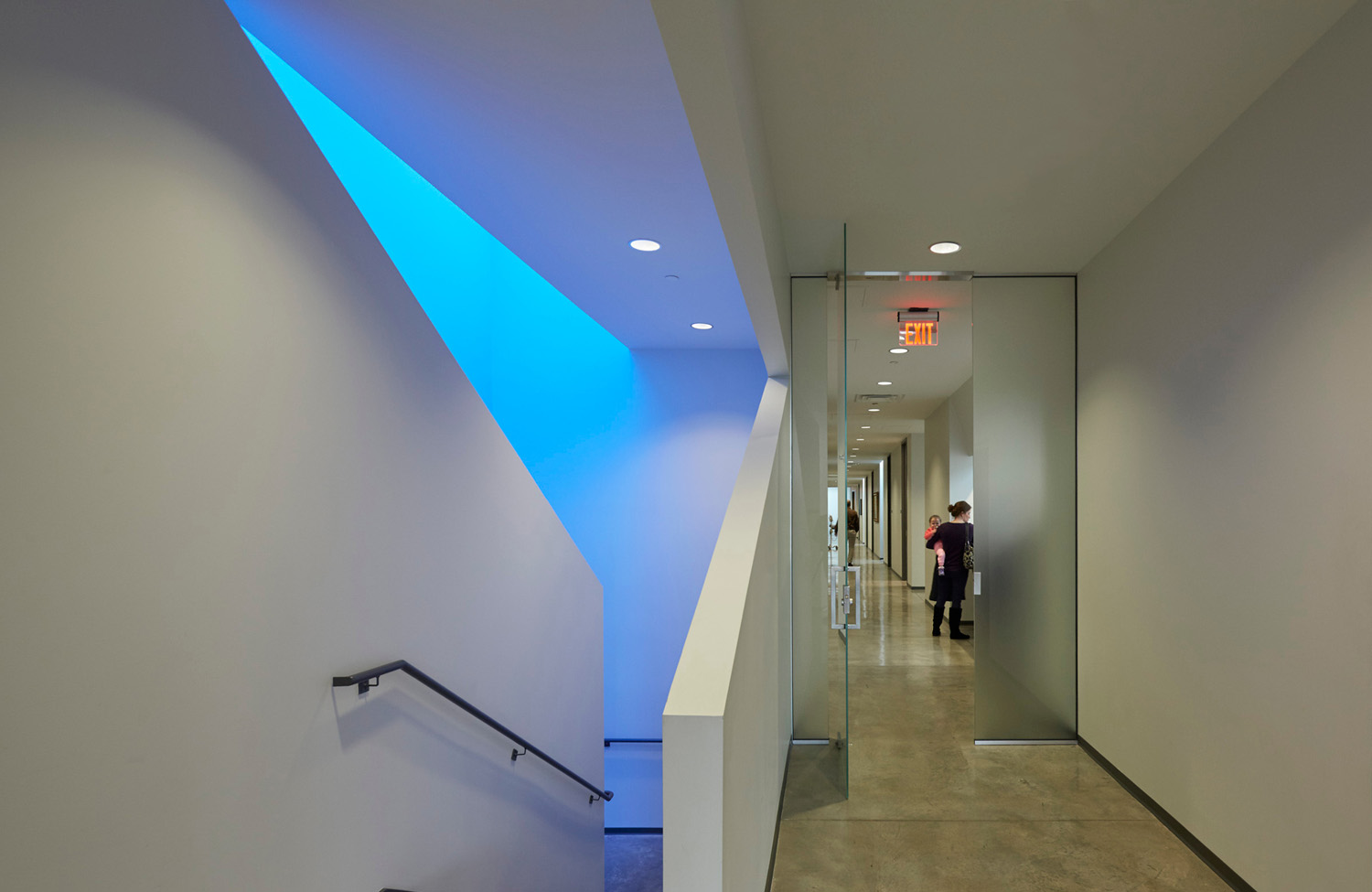 Blue light from the Clinic Stair skylight with the south clinic corridor and Check-out beyond