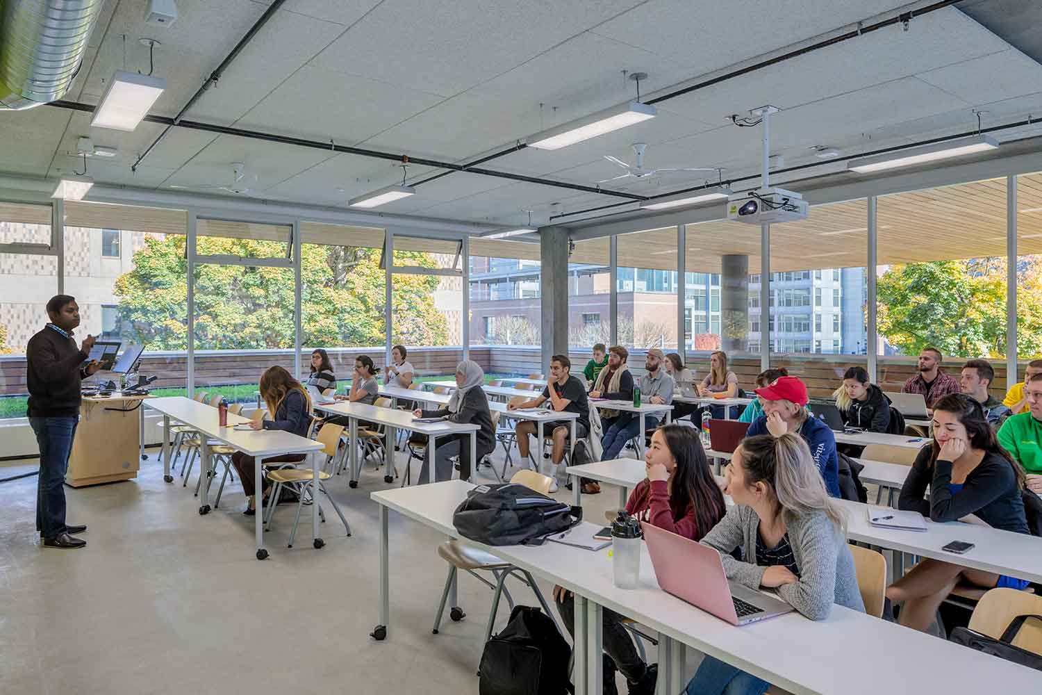 Classroom. Large overhands created by the building geometry reduce solar heat gain. Operable windows provide natural ventilation in all classrooms in the passively cooled new addition. Brad Feinknopf