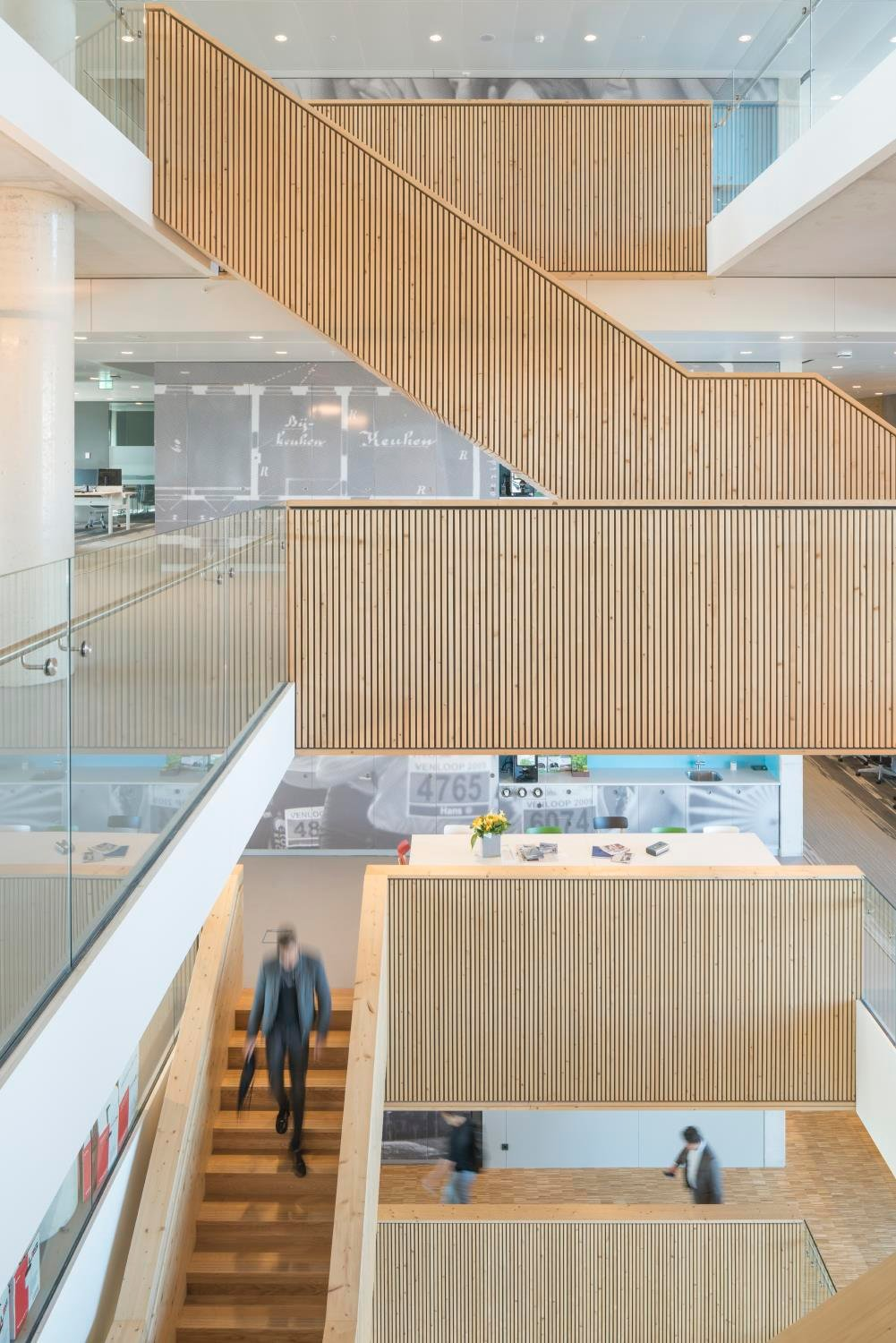 The stairs form the hearth of the building, their openness encourages dropping by colleagues on different floors.