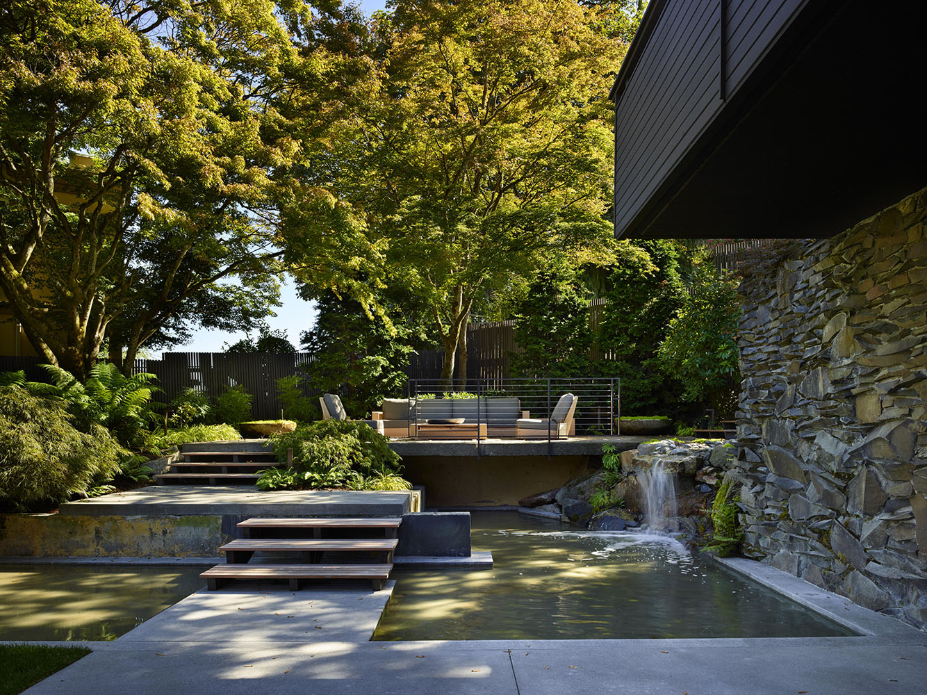 Modern additions such as a raised vegetable garden, water features and patios were added to fit the lifestyle of the client