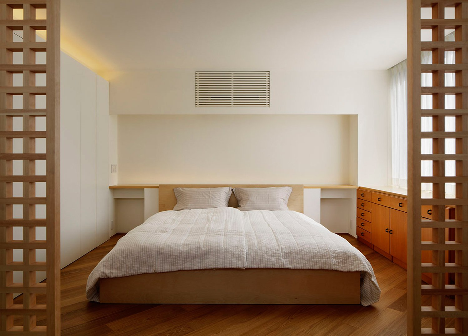 Ash wood furniture that shines on a white wall. Give the room warmth. }