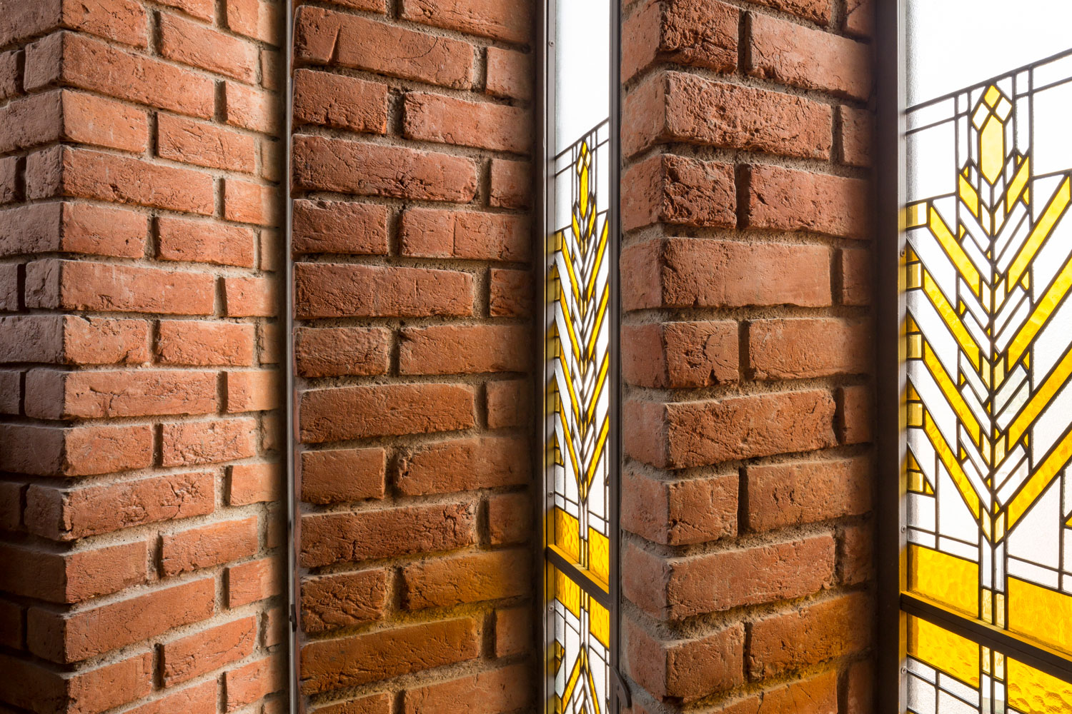 Pivoted stained glass full height windows Randhir Singh}