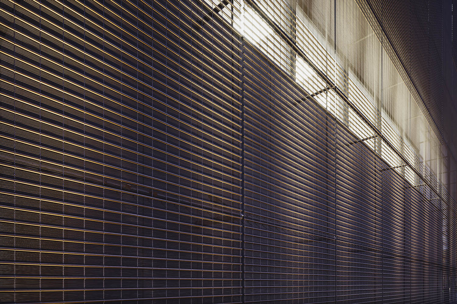 Metal mesh facade by night © Marcus Bredt