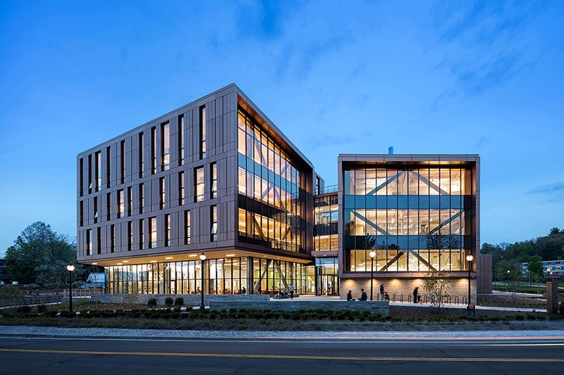 Main entrance at North Pleasant Street: Timber structure is protected from exterior elements and also on full display through expansive area of glazing Albert Vecerka / Esto
