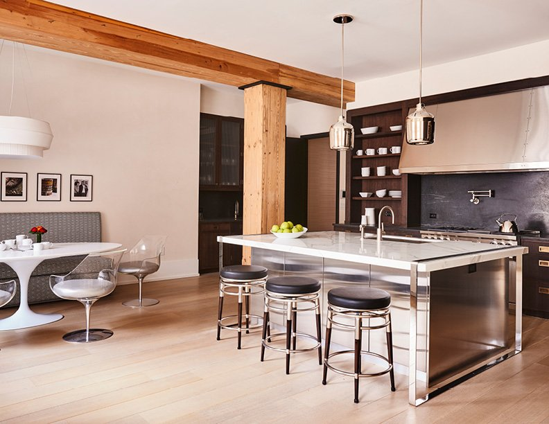 Original 100 year old oak beams that have been restored in the residential plan, framing and unifying the design elements in the kitchen and within each unique residence. Adrian Gaut