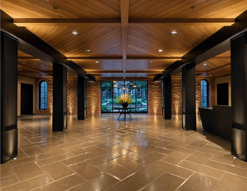Lobby entrance into repurposed courtyard; Ceiling designed with reclaimed wood from existing siteC David Sundberg