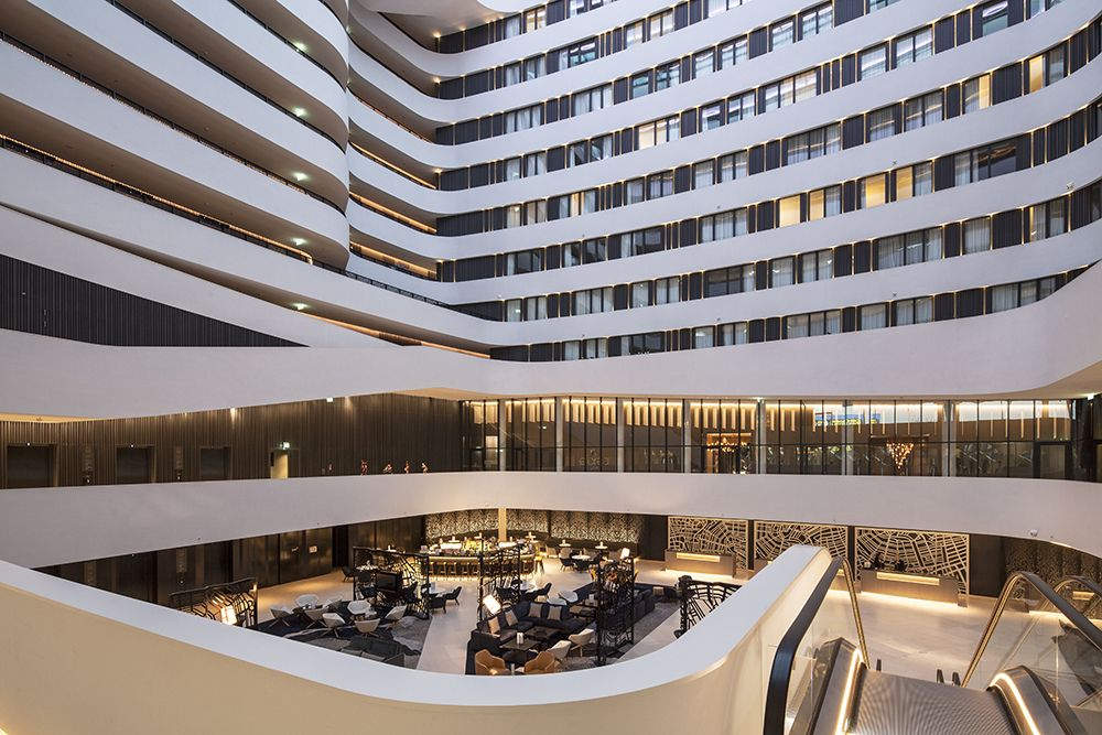 From the smoothly winding galleries, guests have spectacular views of the atrium