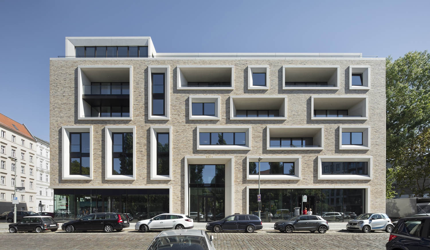 The residential building on Ackerstraße 29 with retail spaces in the ground floor Werner Huthmacher