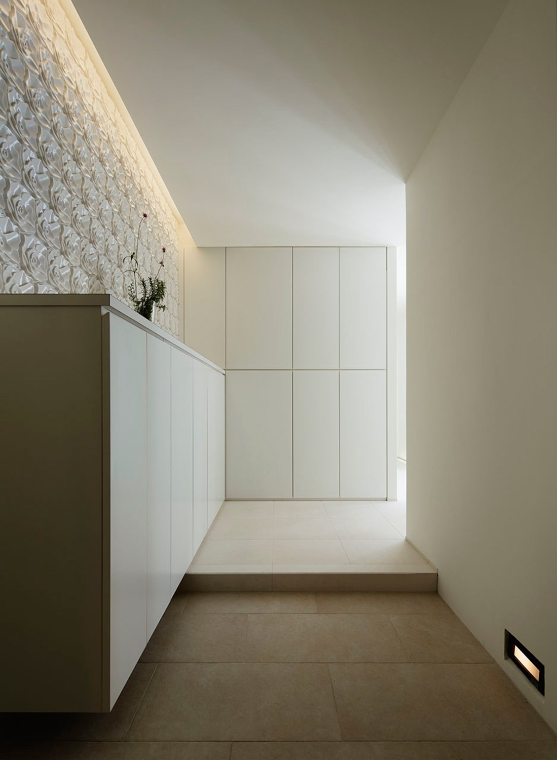 Entrance. A refined space with no waste. }