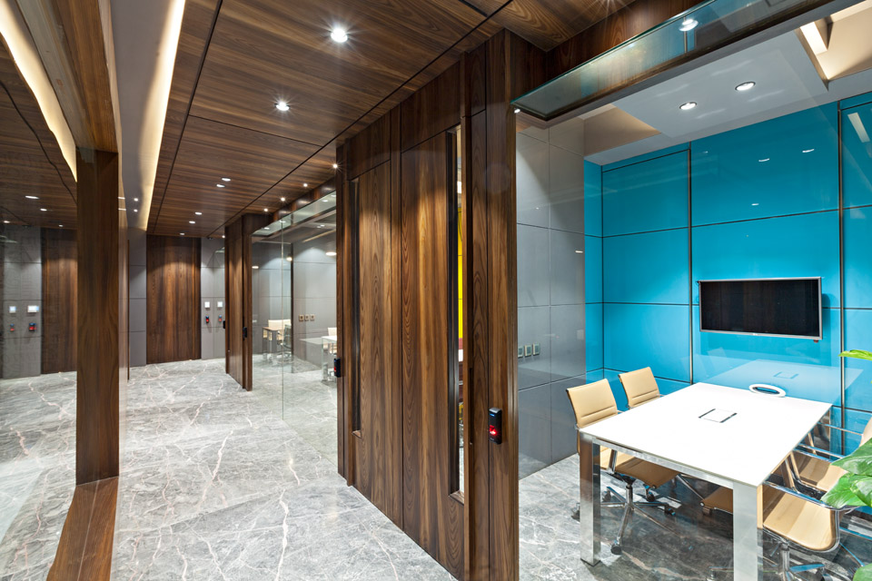 Corridor flanked by vibrant meeting rooms