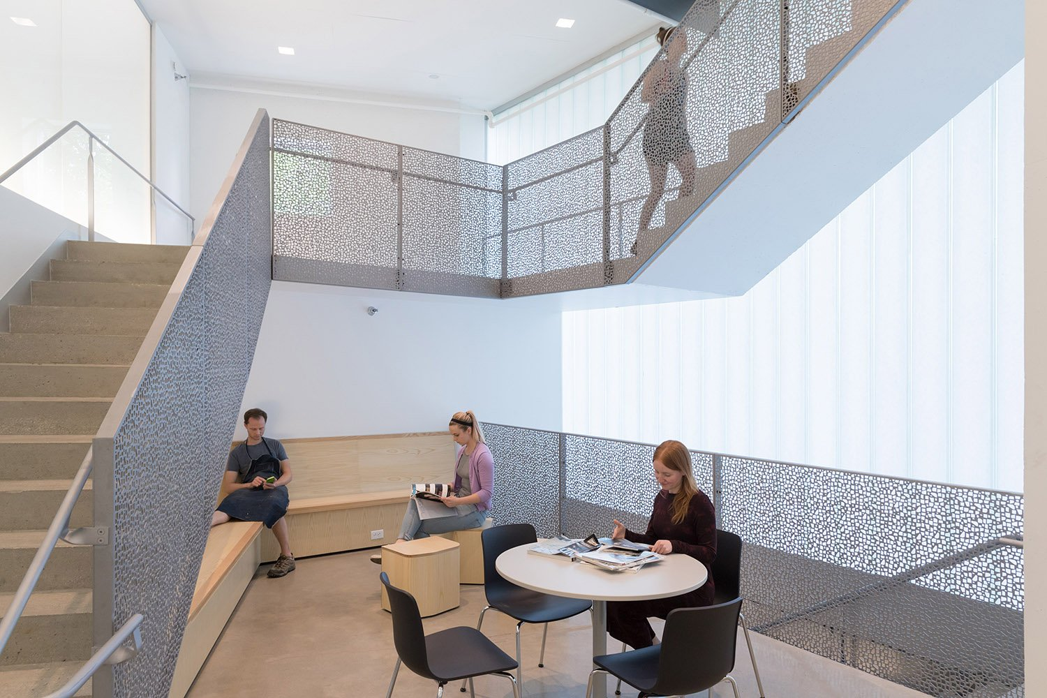 Stairs as vertical social condensors, shaped to enable informal meeting, interaction and discussion.