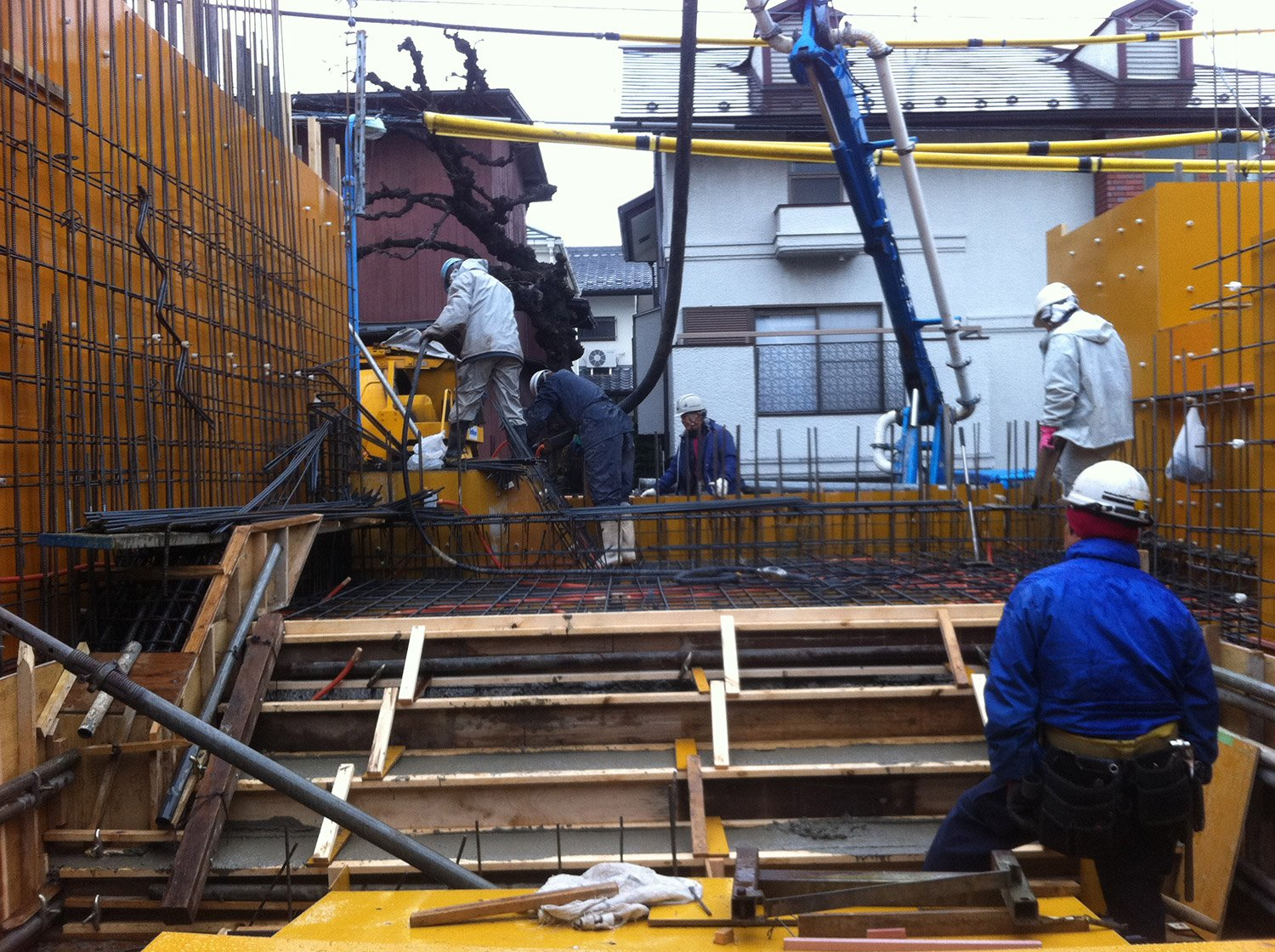 Concrete placing.Work was proceeding carefully in a narrow site.