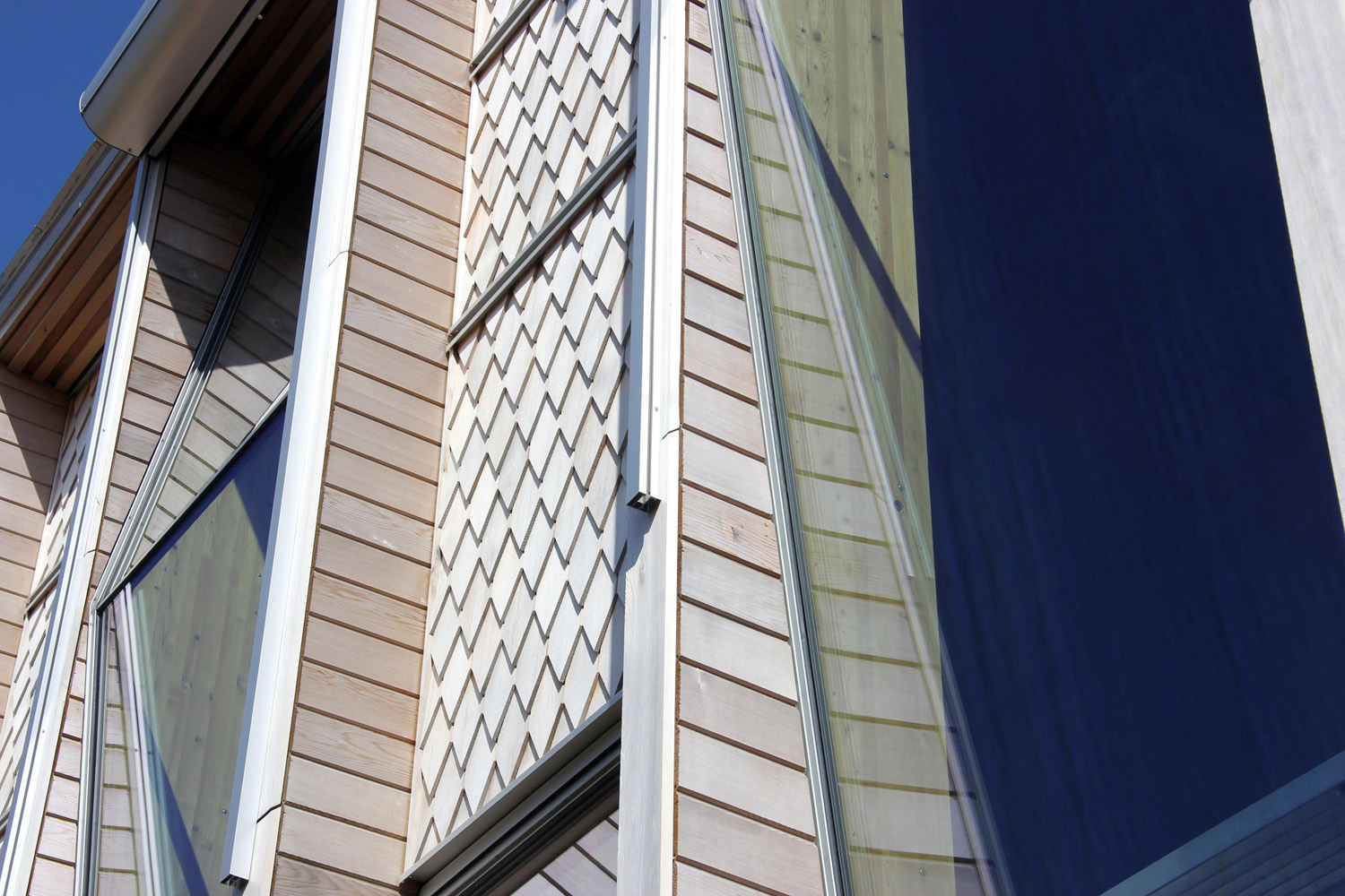 facade detail showing cedar clad timber window system