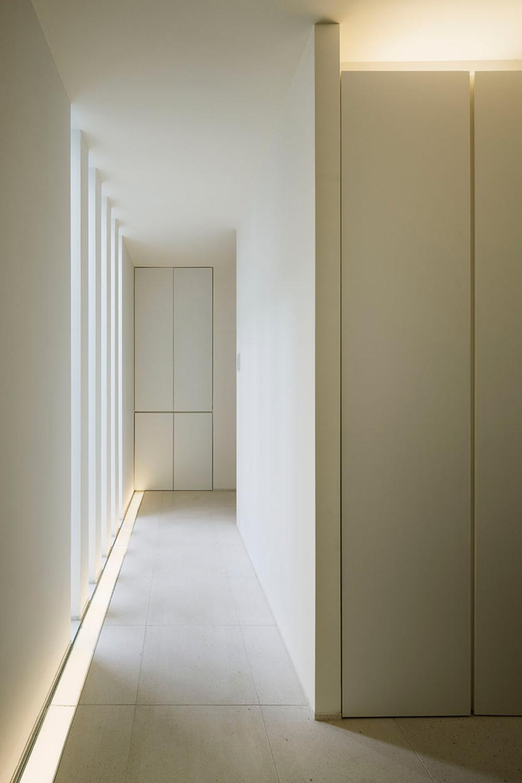 Corridor. Lighting from slit windows and slit lighting. }