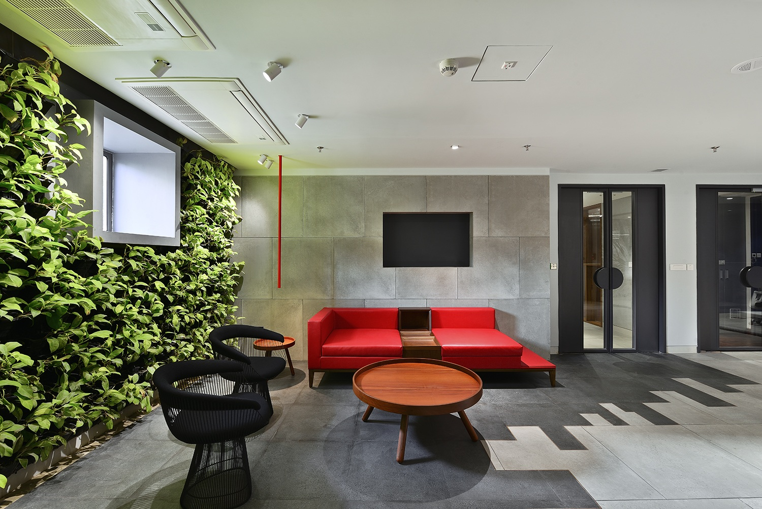 A green wall lends a welcome feel to the Reception Lobby Ravi Kanade