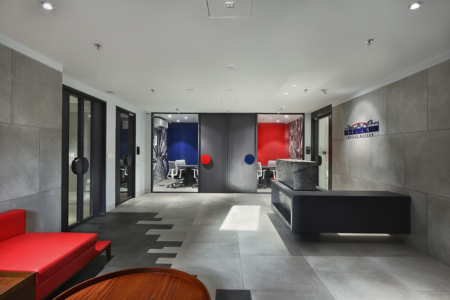 Accents of Blue and Red mirror the company's brand Ravi Kanade