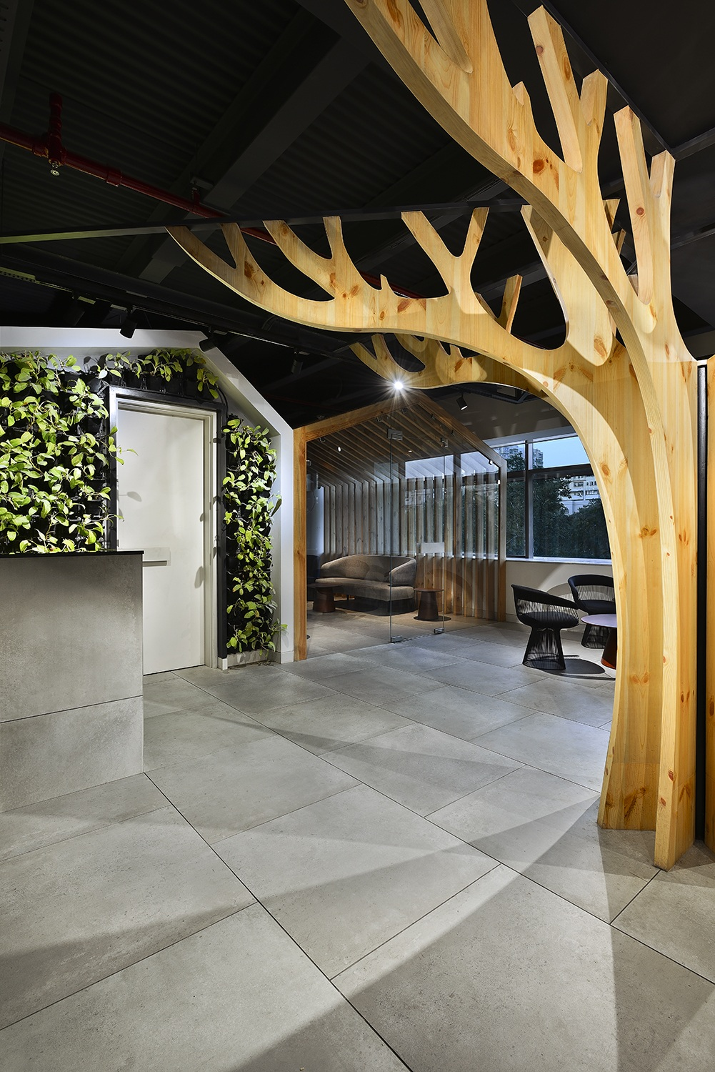 A sculptural tree dominates the Client Interaction Zone Ravi Kanade