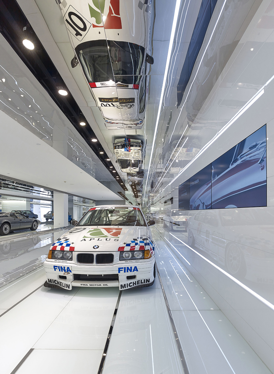 The ceiling mirrors and expands the volumetric space of each display   YANG Chao Ying