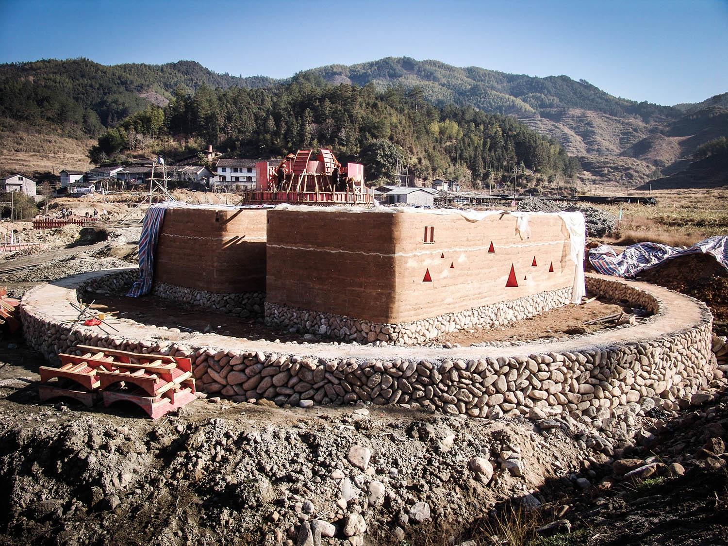 Guest House - construction of the stone foundations and the rammed earth walls