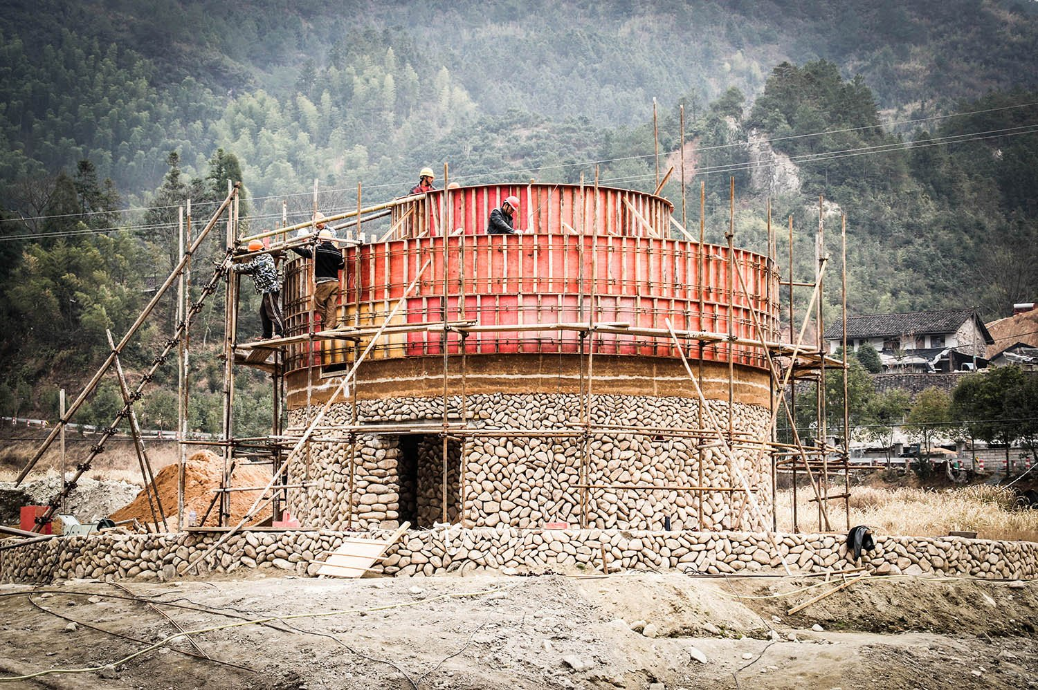 Hostels - construction of the stone basement and the rammed earth wall at the first floor