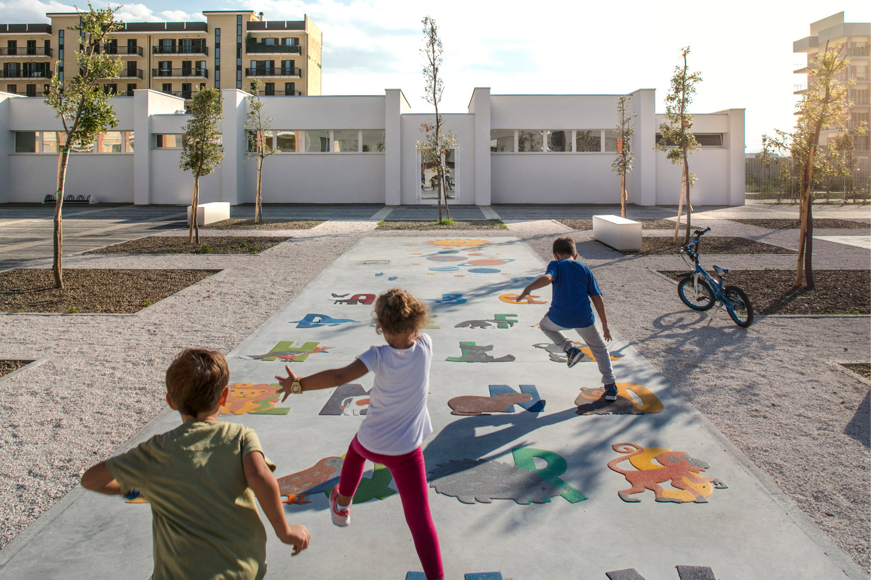Children playing outdoor floor games Luigi Filetici