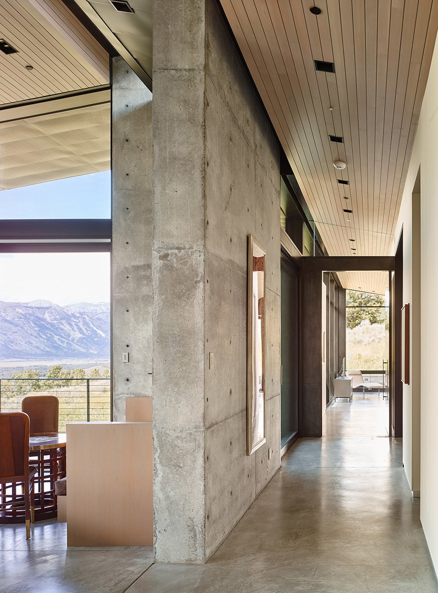 Poured concrete forms the walls and floors inside.  The ceilings sit slightly detached from the adjoining walls to create expansiveness.