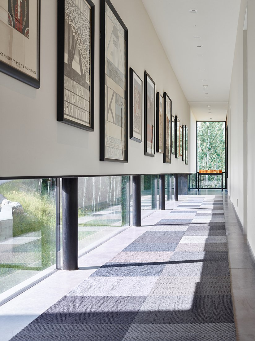 Low windows in the gallery allow natural light to permeate while protecting the sensitive art from harmful direct sunlight.