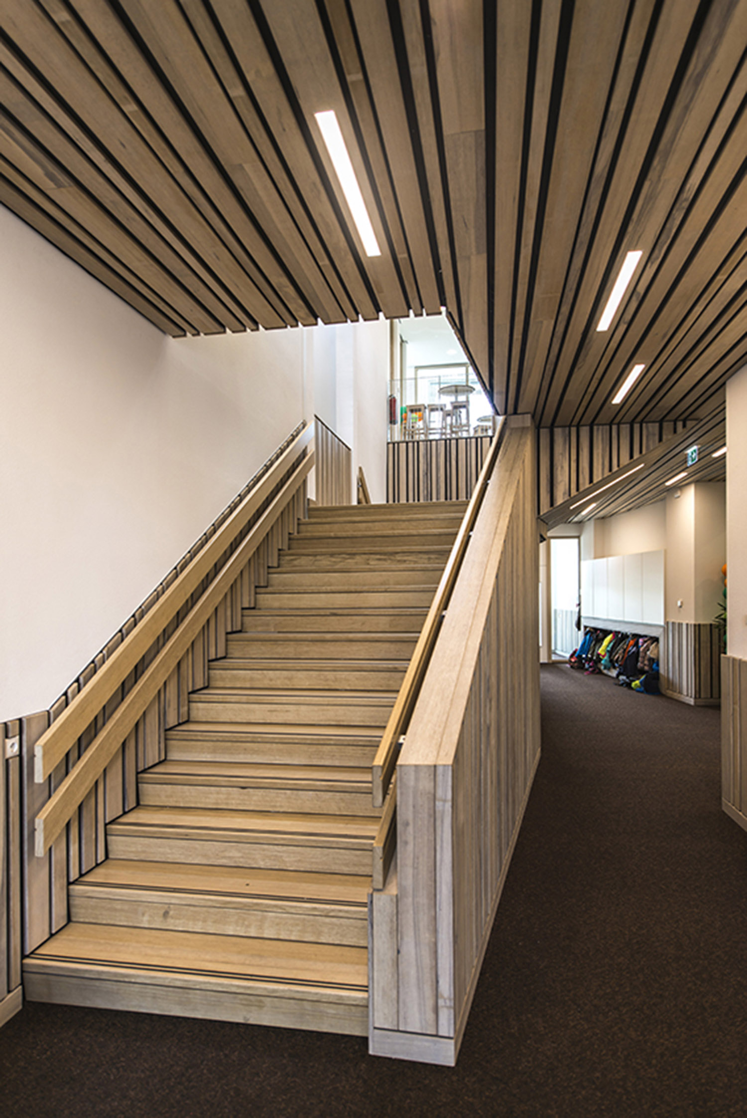 wooden staircase on the ground floor  Daan Dijkmeijer and UArchitects