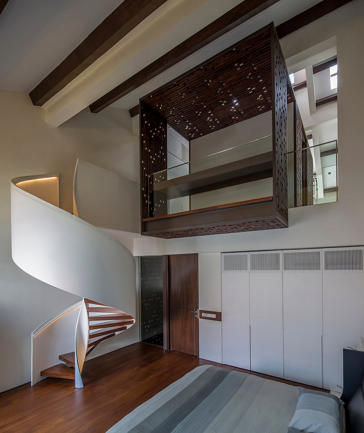Master bedroom with spiral stair and timber screen box infill