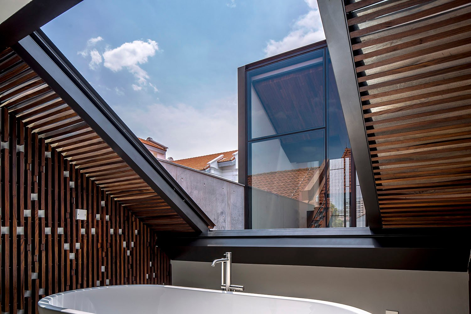 Master bathroom with sliding skylight to views to new block and beyond