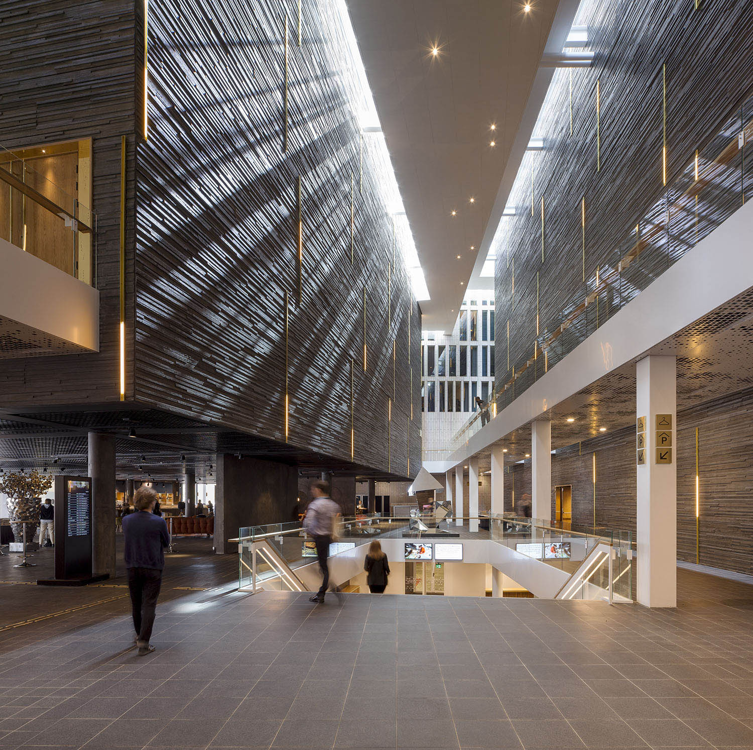 The different functions in the building are organised as separate elements - as a small town