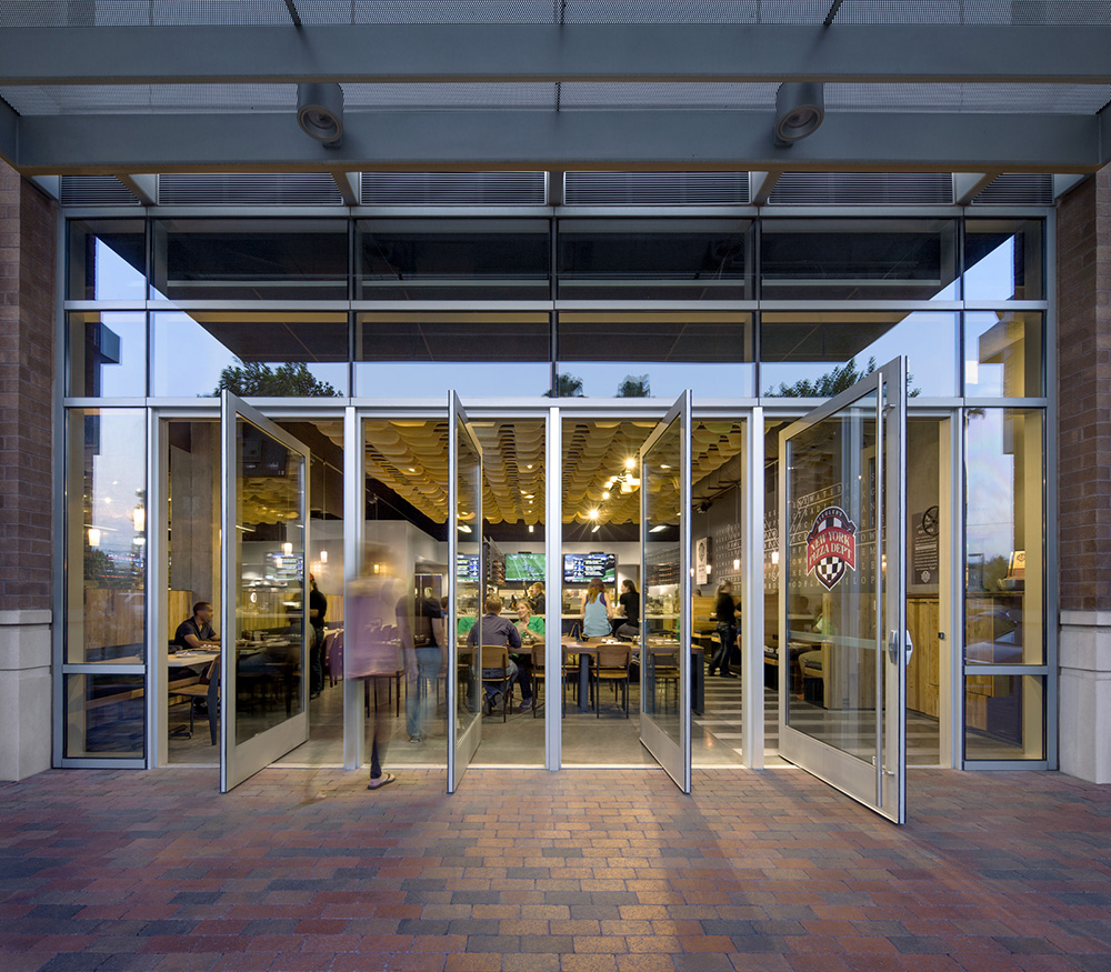 NYPD Tempe Gateway- Pivot doors allow the storefront to open completely to the pedestrian promenade.