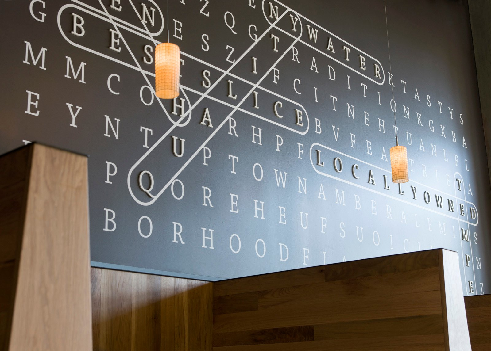 NYPD Tempe Gateway- An oversized word-search incites diners to explore the space further.