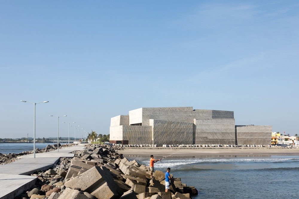 Jetty´s crude concrete blocks on the pier and the Concert Hall.  Paul Rivera