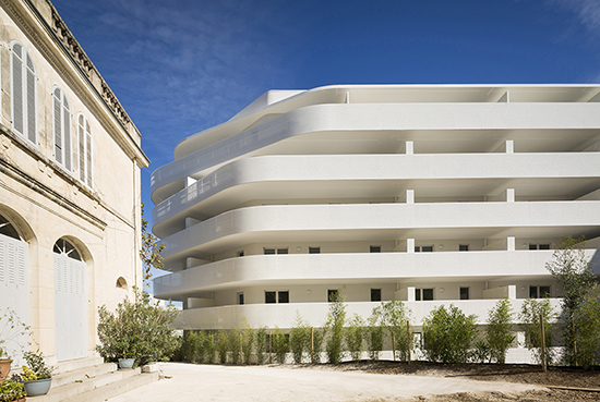 The housing project is located next to an old building Mathieu Ducros