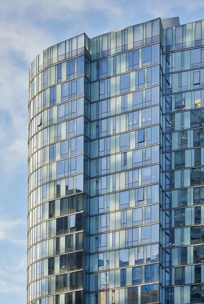 The building's glass and metal skin is a mosaic of clear, translucent, and opaque glass. Benjamin Benschneider