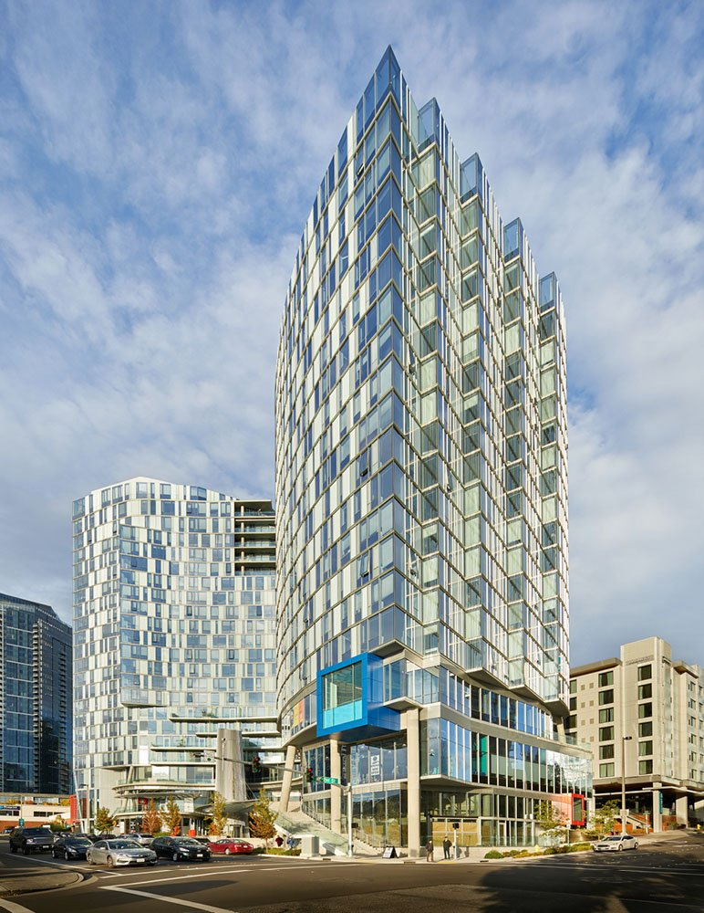 The 18- and 21-story towers include 273 one- and two- bedroom living units. Benjamin Benschneider