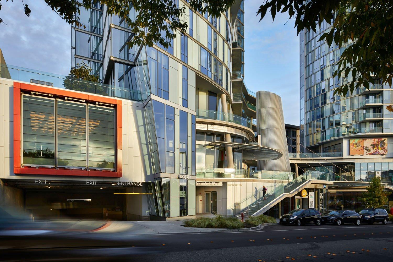 A multilayered podium of tiered public plazas enliven the neighborhood with local retailers. Benjamin Benschneider