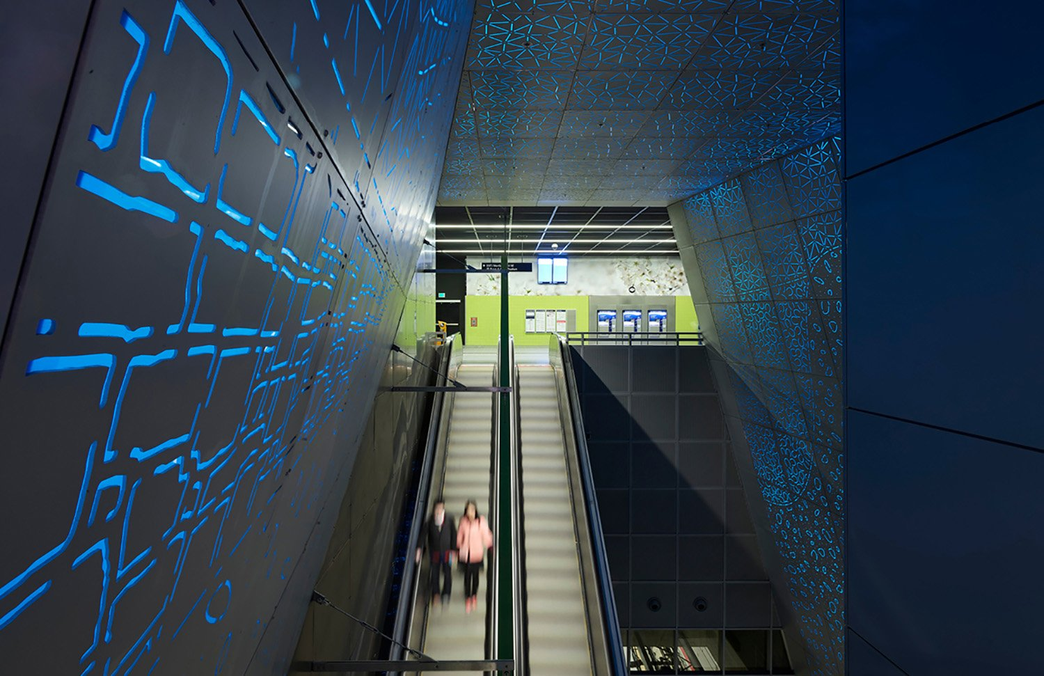 Between the surface and the train platform 100 feet below, circulation paths and visual connections between multiple levels orient users to the station's overall volume, structure and internal flow. Kevin Scott