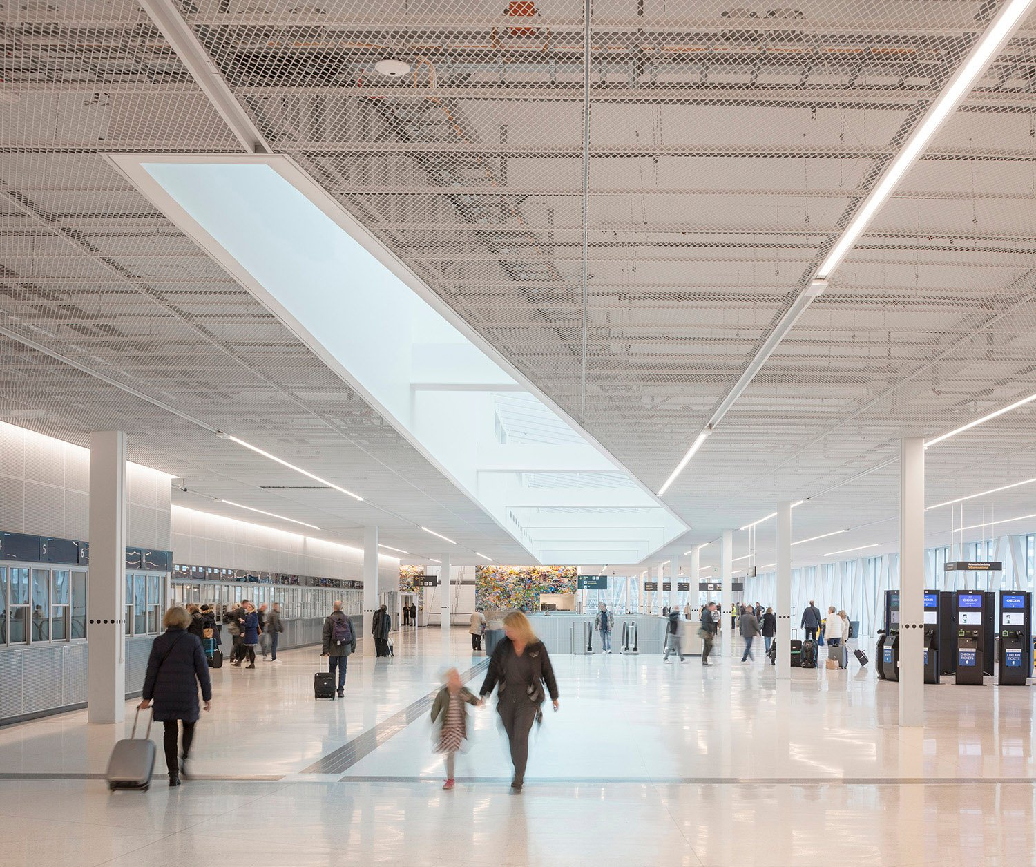 View of the departure hall with skylight and integrated art.